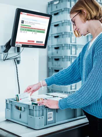 RFID Arbeitstisch zum Kommissionieren und Verpacken von Waren
